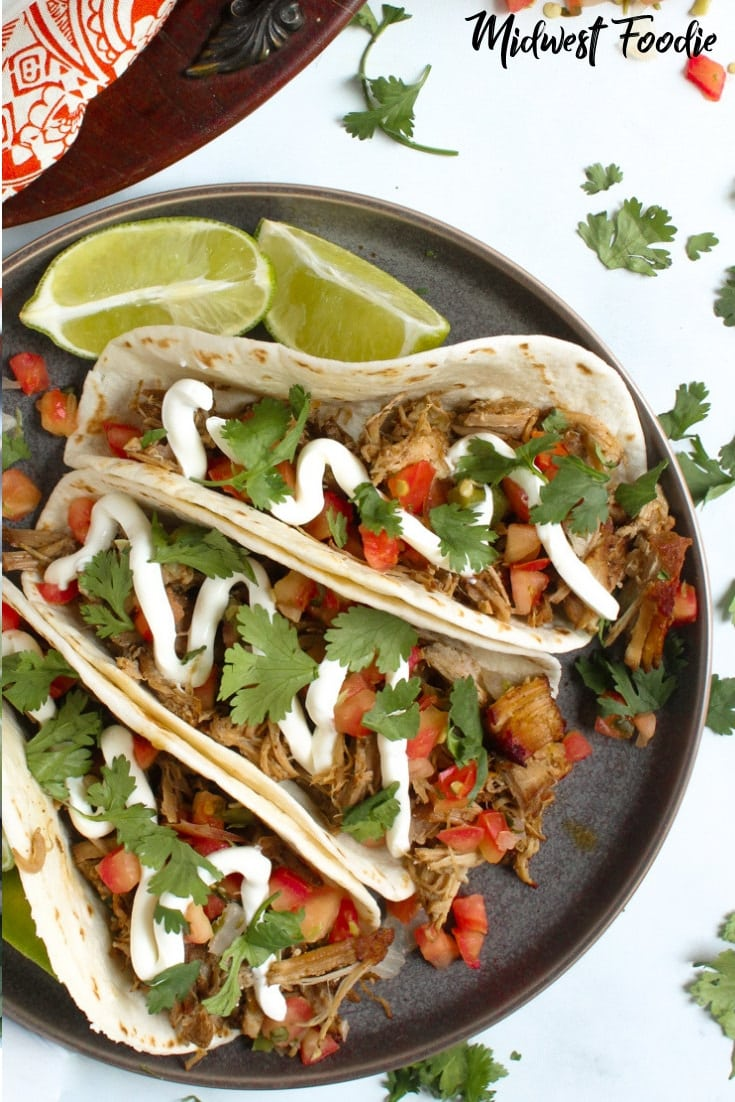 Slow Cooker Beer Braised Pork Carnitas | Midwest Foodie | These carnitas are juicy and tender, but also crisp and loaded with flavor. Best of all, they are SUPER easy to make. 20 minutes of prep and your crock pot does the rest. #tacos #slowcooker #crockpot #easy #simple #dinner #mealprep #family #pork #carnitas