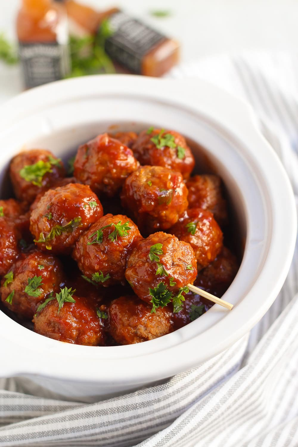 Slow cooker filled with bourbon whiskey barbecue meatballs