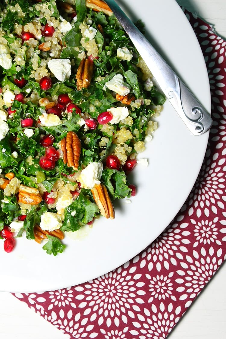 Kale salad loaded with goat cheese quinoa pecans and pomegranate seeds