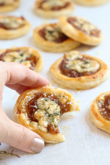 Caramelized onion and blue cheese tarts garnished with a drizzle of honey and sprinkled with fresh thyme