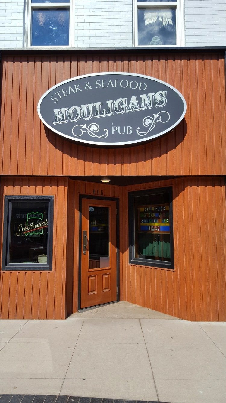 The front of a local downtown restaurant called houligans
