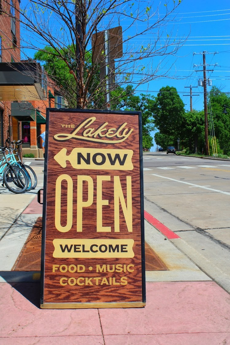 The Lakely is now open sign out front of a restaurant on the food tour
