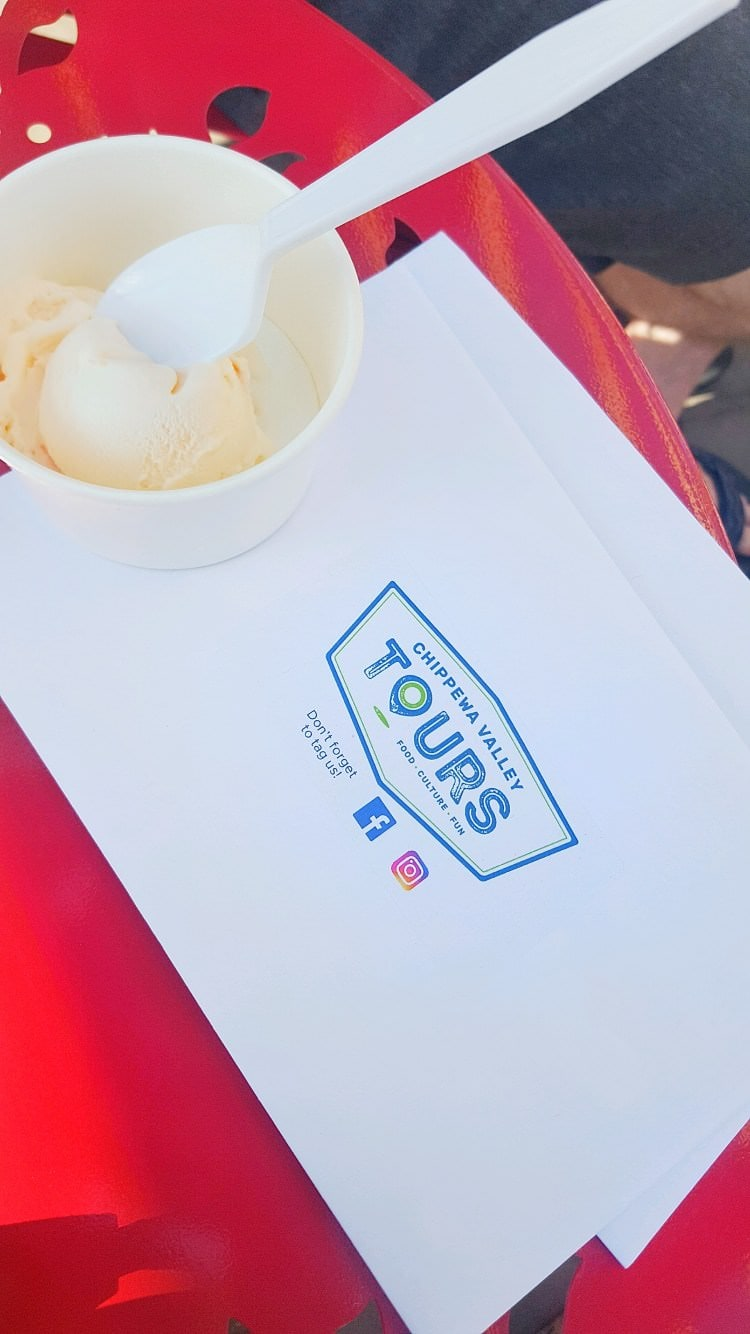 An envelope from Chippewa Valley Food Tours with a dish filled with ice cream on top