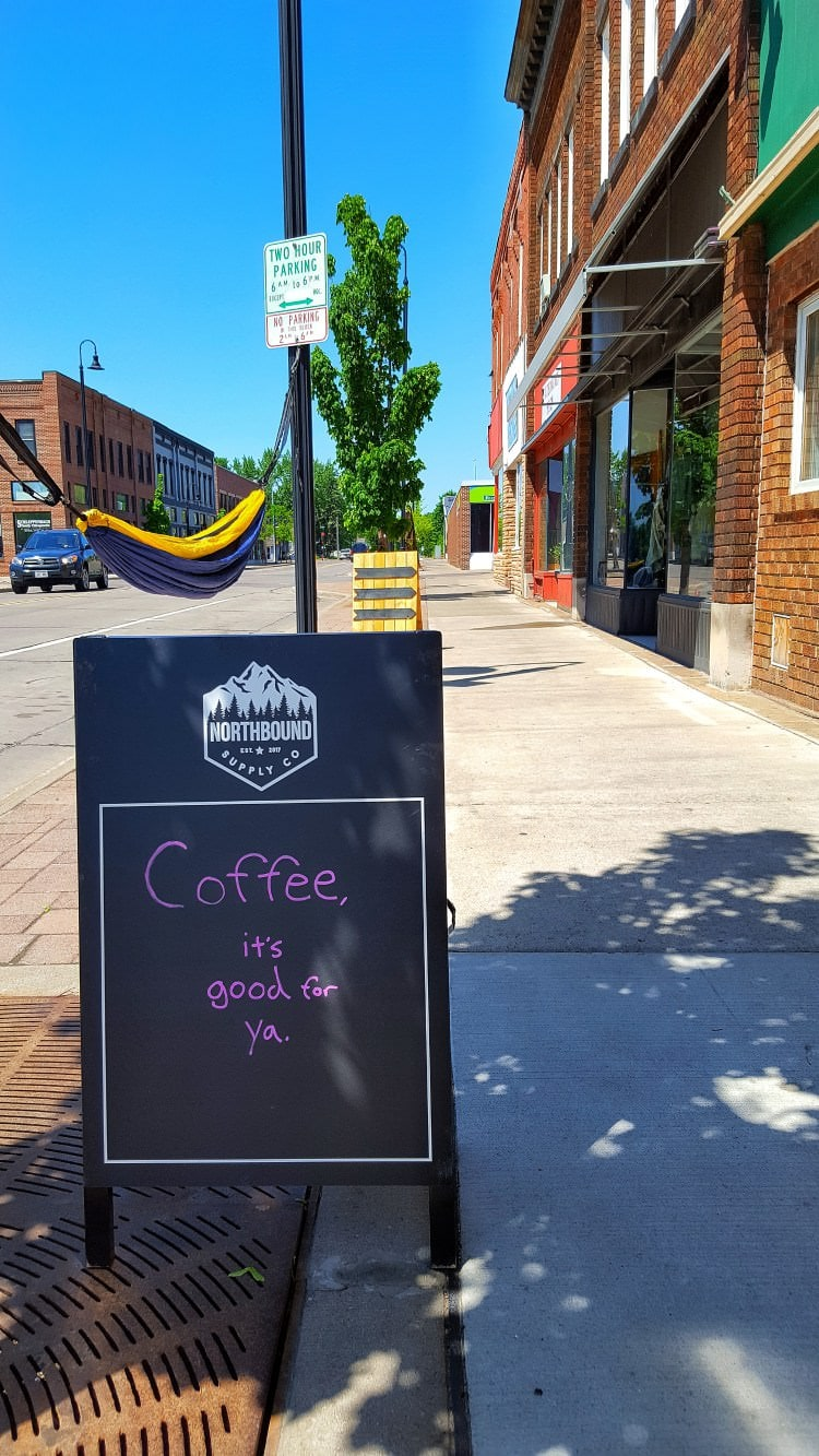 The welcome sign outside of the second stop on the food tour, a coffee shop