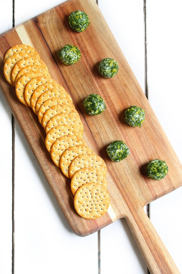 Lemon and dill goat cheese bites served with whole wheat crackers