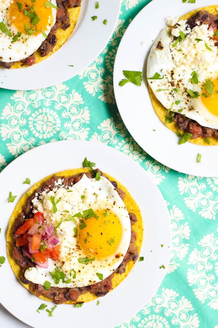 Vegetarian brunch tostadas loaded with fried egg pico de gallo and fresh chopped cilantro