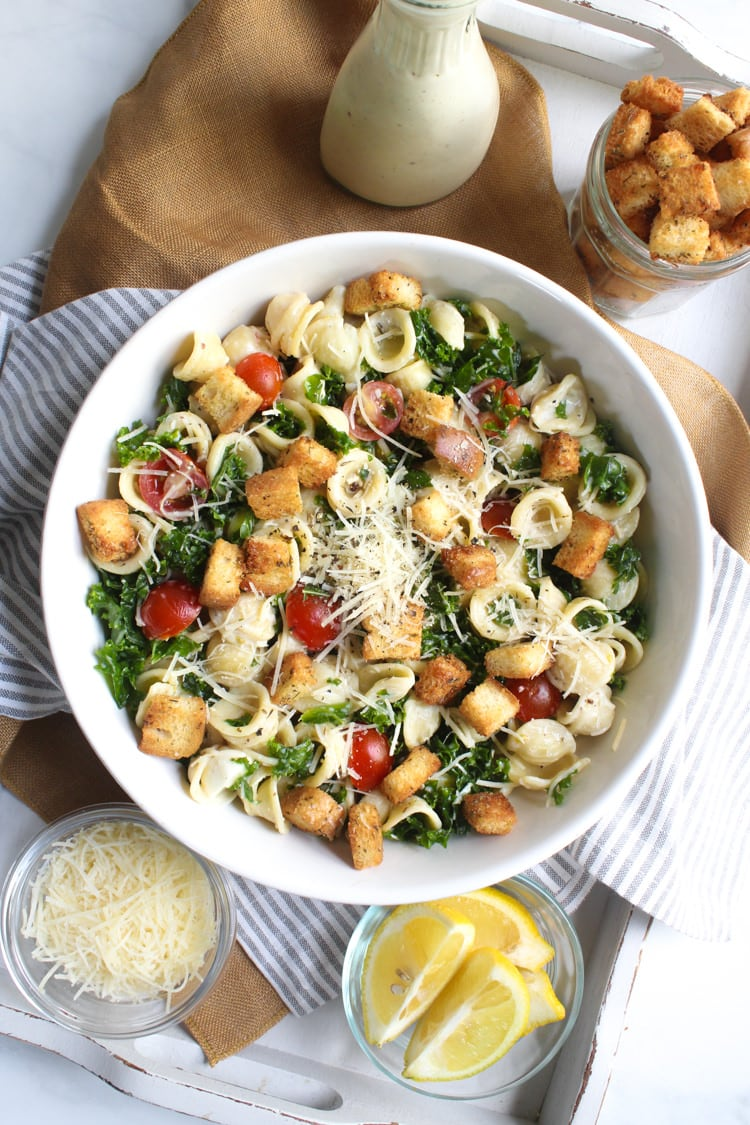 Loaded with kale, cherry tomatoes, fresh mozzarella and Parmesan cheese, tossed in a low calorie (but very flavorful) yogurt based dressing!