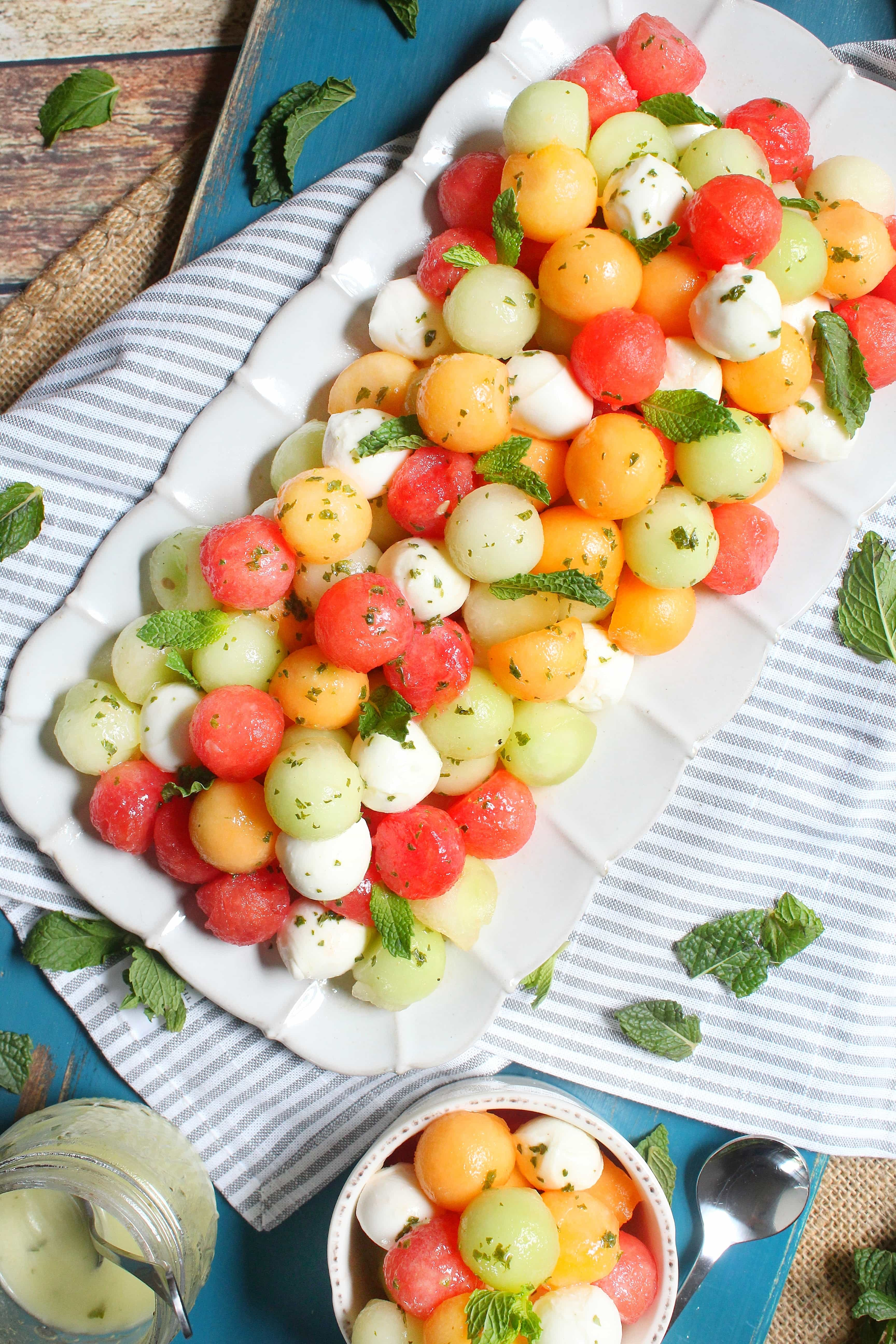 Melon and Mozzarella Salad with Mint Vinaigrette -- the perfect summer starter or dessert. Simple, elegant and delicious!