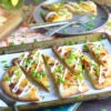 Loaded baked potato flatbread pizza with bacon green onions and sour cream
