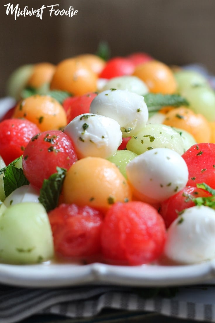 Melon and Mozzarella Salad with Mint Vinaigrette | midwest foodie | This salad is about as easy as it gets. Three kinds of melon, cute little balls of fresh mozzarella and a mint vinaigrette with 6 ingredients that comes together in your food processor in about 5 seconds. Showcase your fresh summer melons in this super simple, healthy recipe! #midwestfoodie #watermelon #summer #salad #healthy #mint #easy #simple