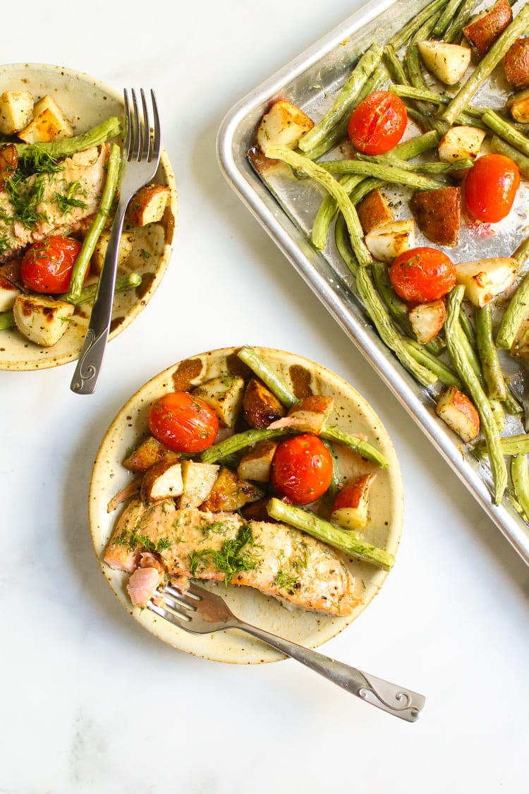 Sheet pan salmon roasted with tomatoes green beans and potatoes