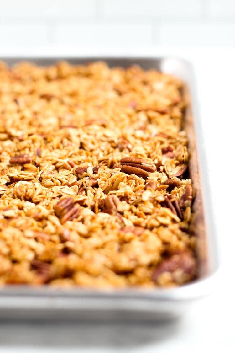 Baking sheet filled with homemade vegan maple pecan granola