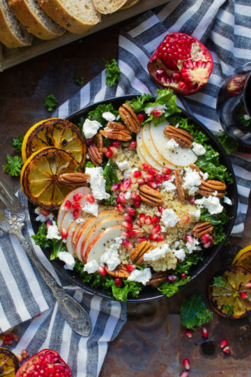 Harvest fall kale salad loaded with apples, pecans, goat cheese and pomegranate seeds