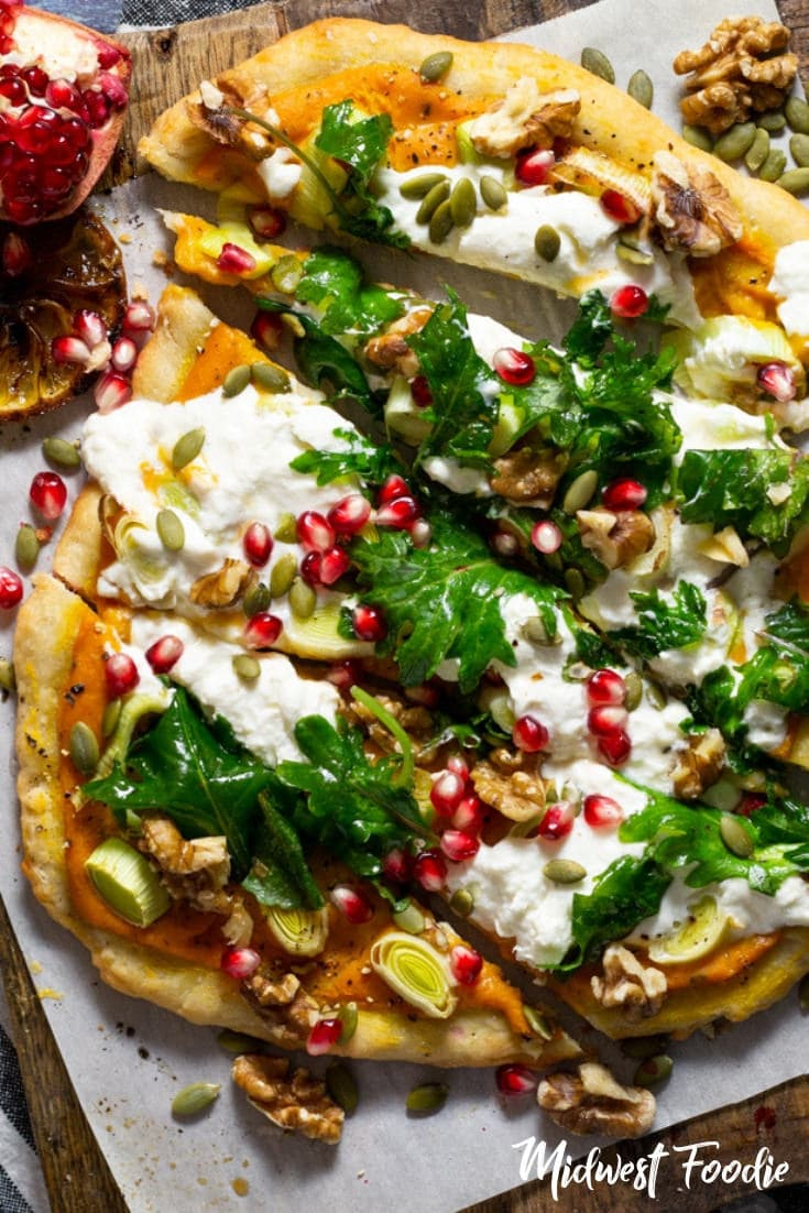 Fall Harvest Vegetarian Pizza with Roasted Squash Cream Sauce | Midwest Foodie | This fall harvest vegetarian pizza combines my favorite no knead pizza doughwith roasted squash cream sauce and sliced leeks, topped with creamy burrata and fresh arugula tossed in a grilled lemon vinaigrette. #midwestfoodie #family #dinner #weeknight #meal #simple #healthy #easy #recipe
