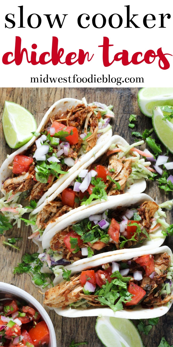 Healthy Slow Cooker Chicken Tacos | These slow cooker chicken tacos are healthy, tasty and almost too easy to make! Toss everything in the crock pot, come back a few hours later, shred the chicken and you're ready to sit down for dinner. I like to serve these tacos with my famous chipotle slaw because the crunchy veggies just compliment the shredded chicken so well. #midwestfoodie #tacos #mealprep #simple #recipe