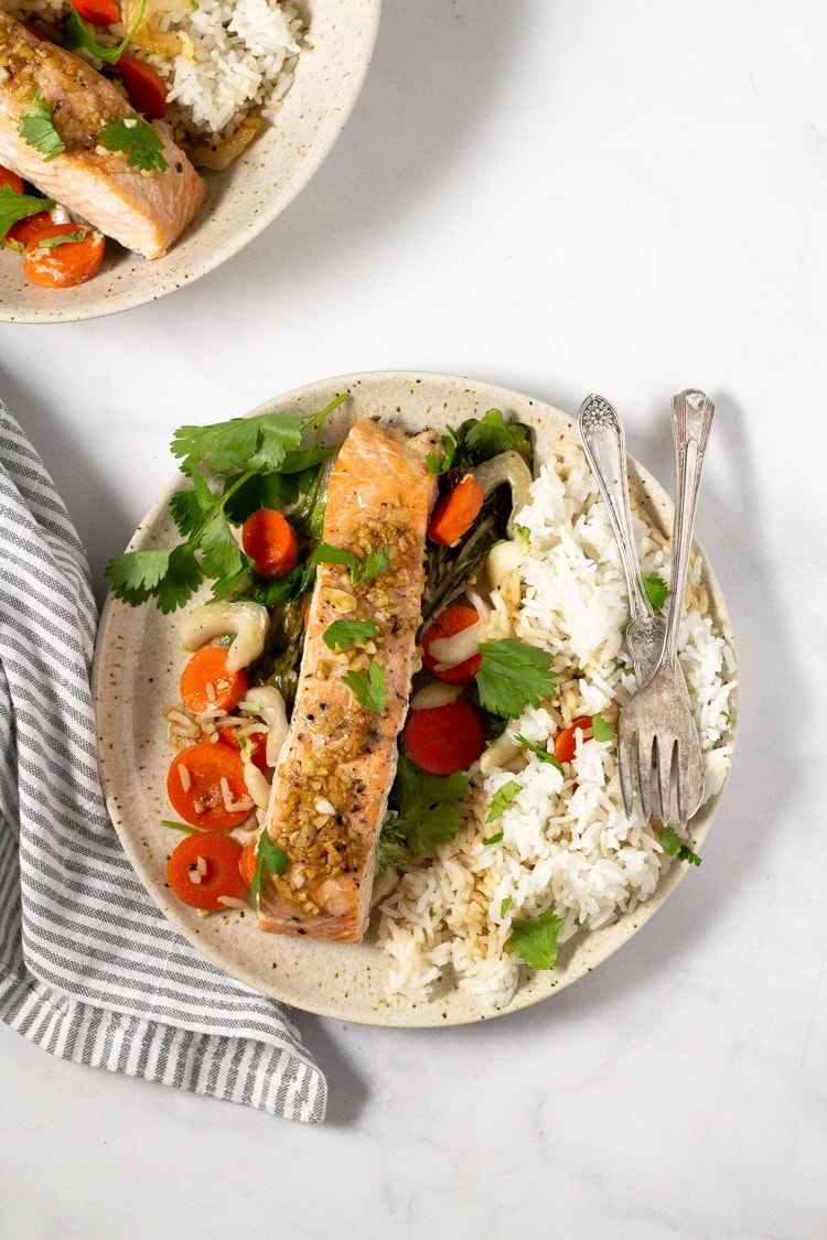 Overhead shot of parchment baked salmon with veggies
