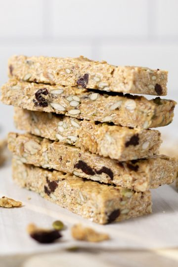 Stack of homemade chewy granola bars on the counter