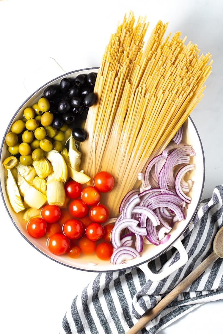 A pot filled with all the ingredients for Mediterranean One Pot Pasta