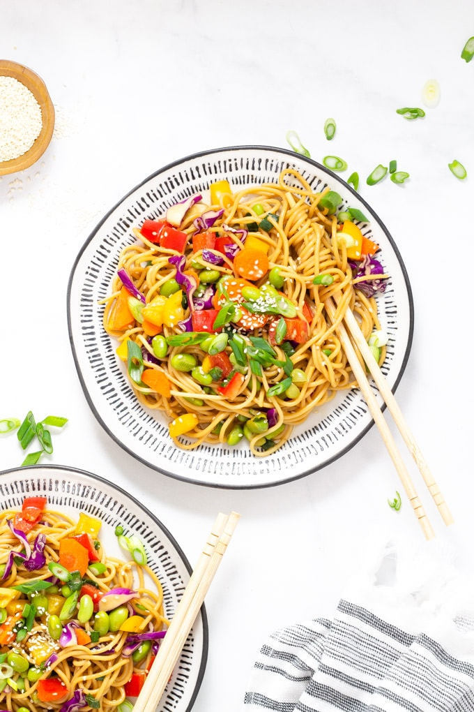 Two plates of vegan sesame ginger pasta salad