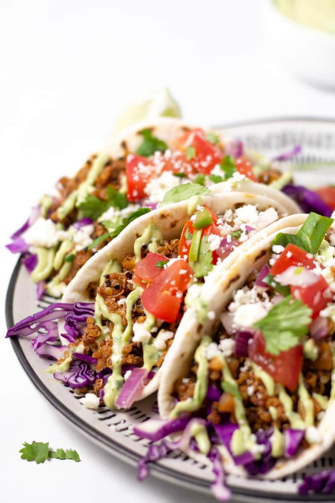 Close up of vegan tacos on a white plate