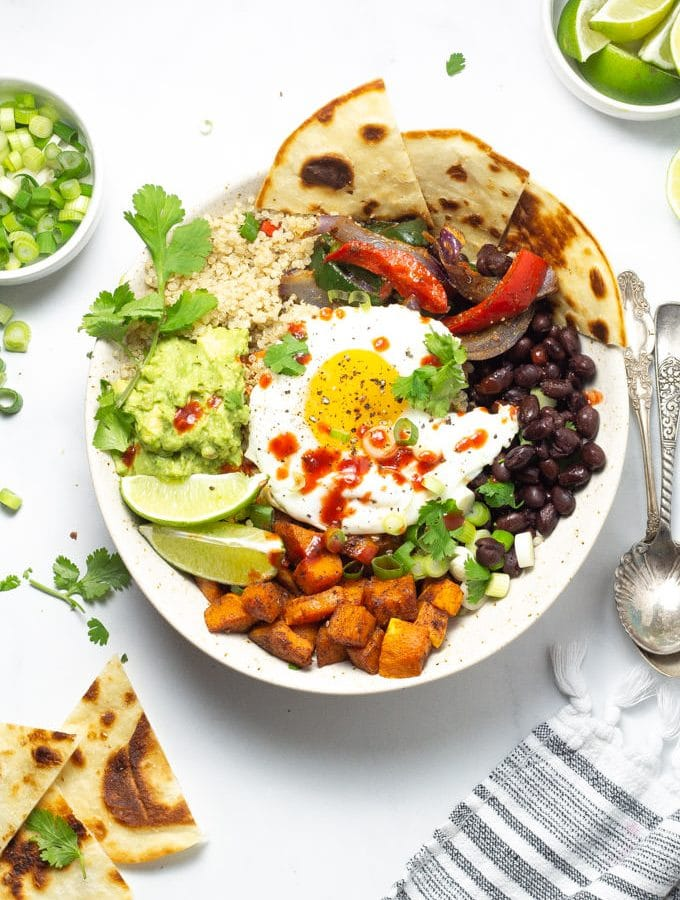 Overhead shot of a bowl filled with Mexican breakfast potatoes beans and eggs