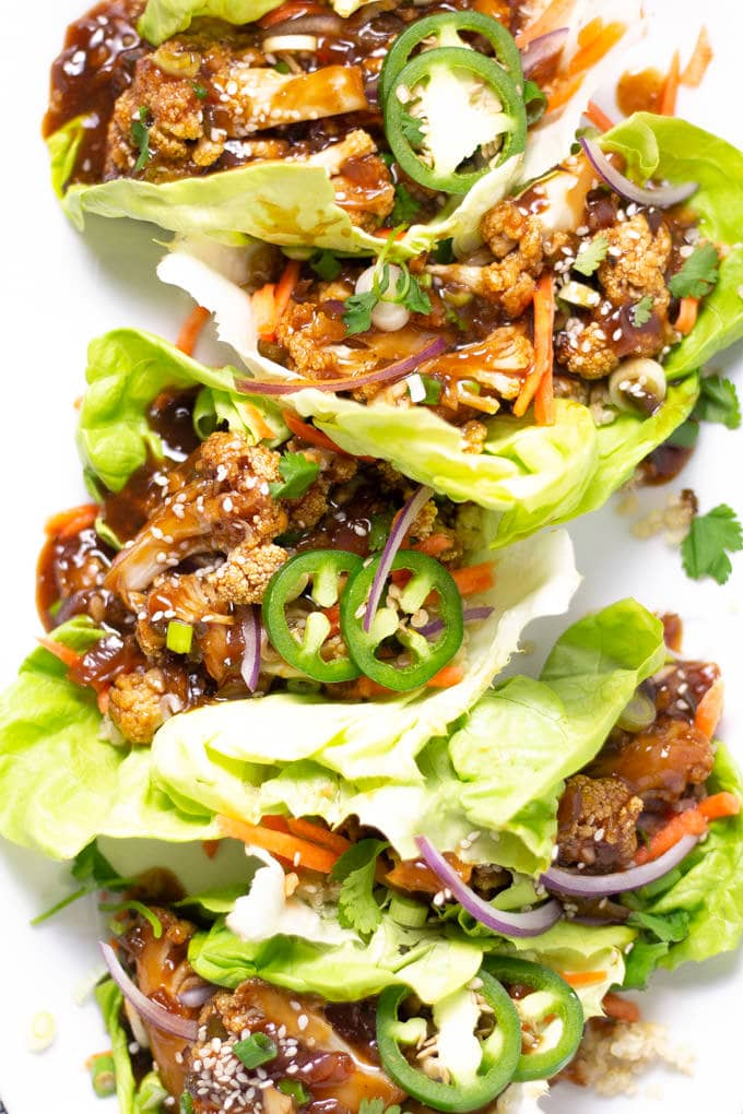 Overhead shot of Korean Cauliflower Lettuce Wraps on a white serving platter