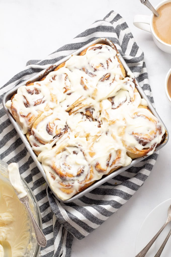A big pan of homemade cinnamon rolls with cream cheese frosting