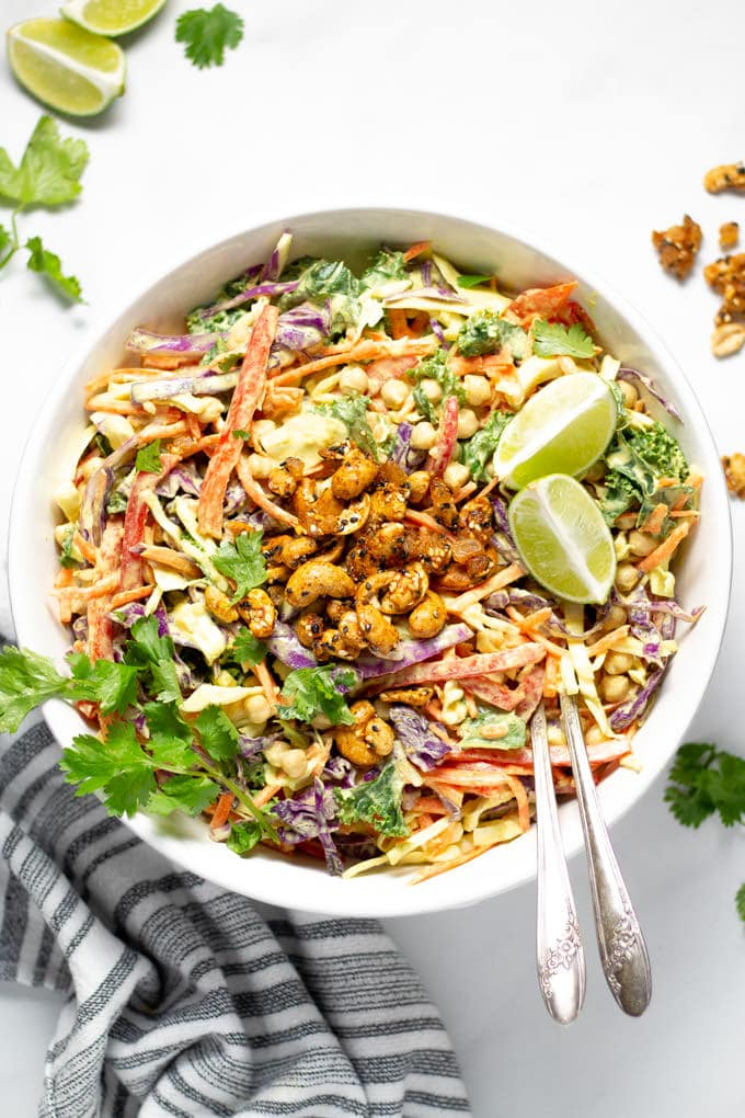 Overhead shot of curry slaw garnished with fresh cilantro and lime