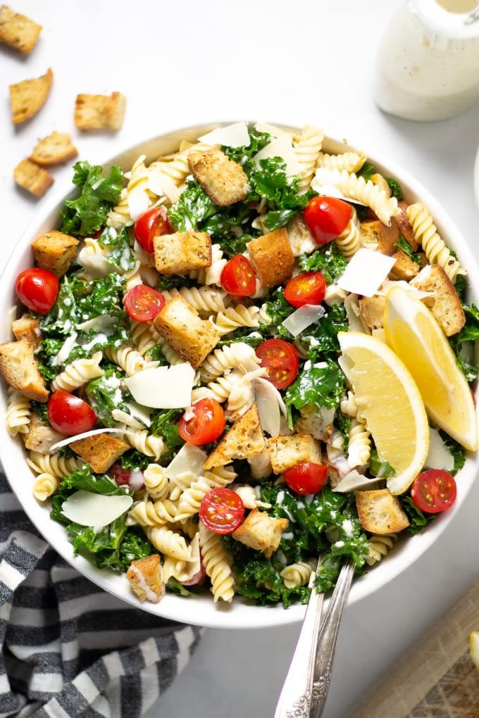 Overhead shot of a serving bowl filled with Kale Caesar Salad