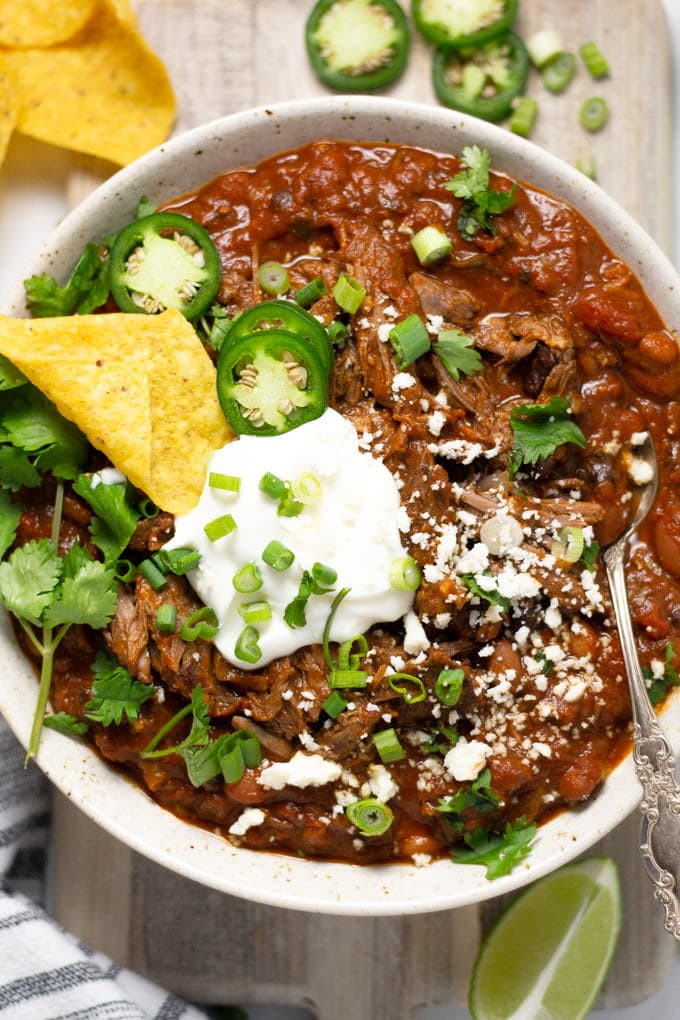 Overhead shot of a bowl of short rib chili garnished with fresh cilantro
