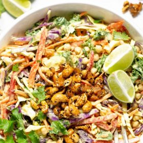 Pinterest pin of curry coleslaw garnished with fresh parsley