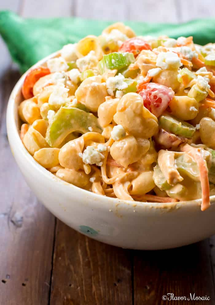 Close up shot of a white bowl filled with buffalo chicken pasta salad