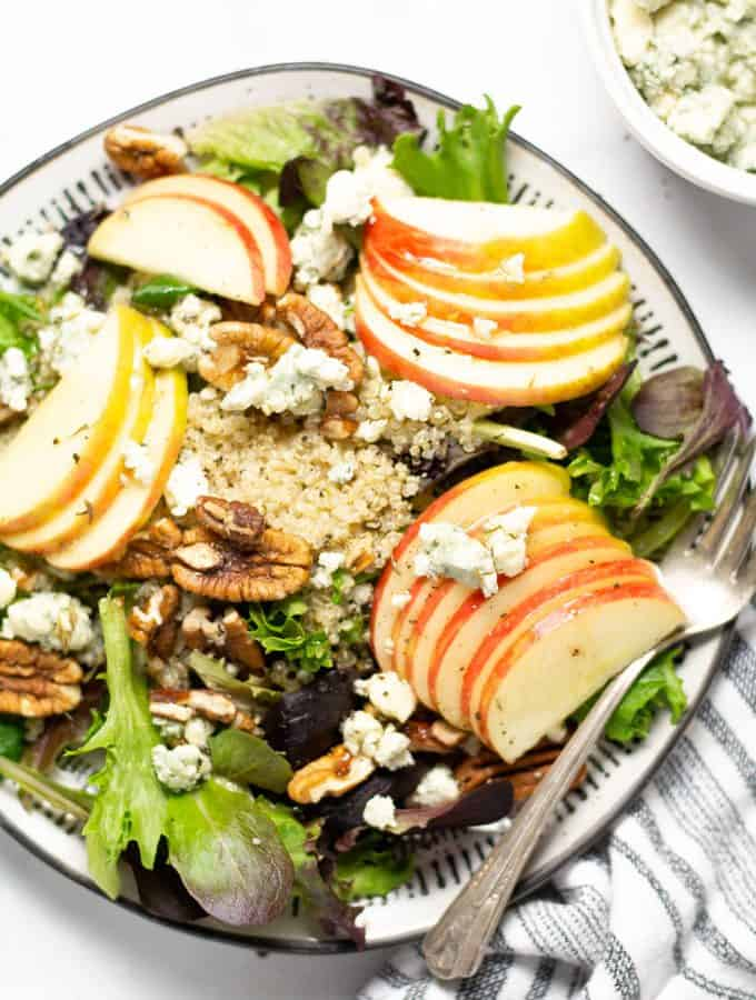 Overhead shot of a sliced apple salad with Gorgonzola cheese