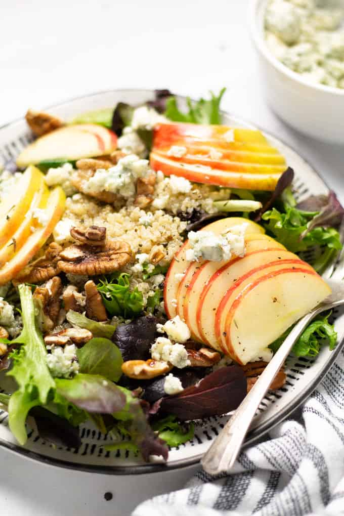 Close up shot of apple pecan salad with crumbled Gorgonzola and quinoa