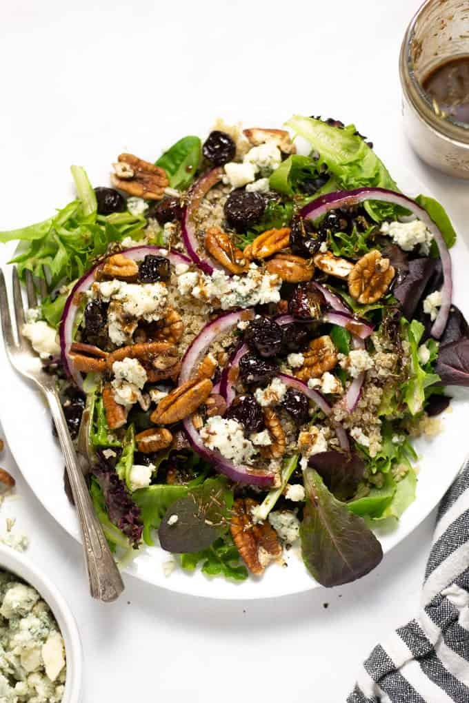 Overhead shot of a dried cherry salad with Gorgonzola cheese and red onions