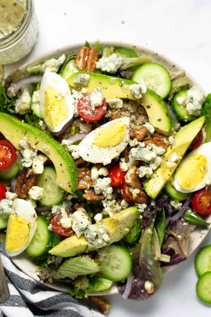 Close up shot of a fresh cobb salad drizzled with Gorgonzola dressing