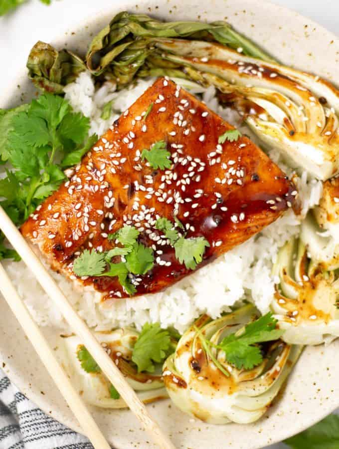 Overhead shot of Asian salmon in a bowl with rice and bok choy