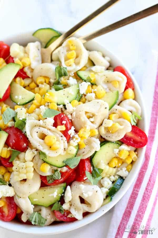 Overhead shot of tortellini salad with corn and tomato