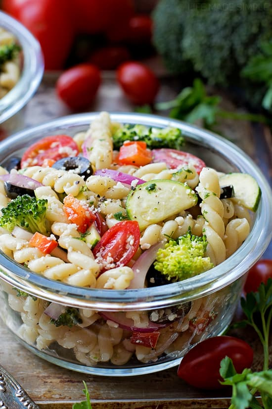 Close up shot of a pasta salad loaded with fresh veggies