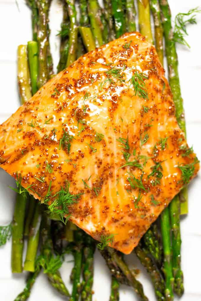 Close up shot of honey mustard sheet pan salmon and asparagus