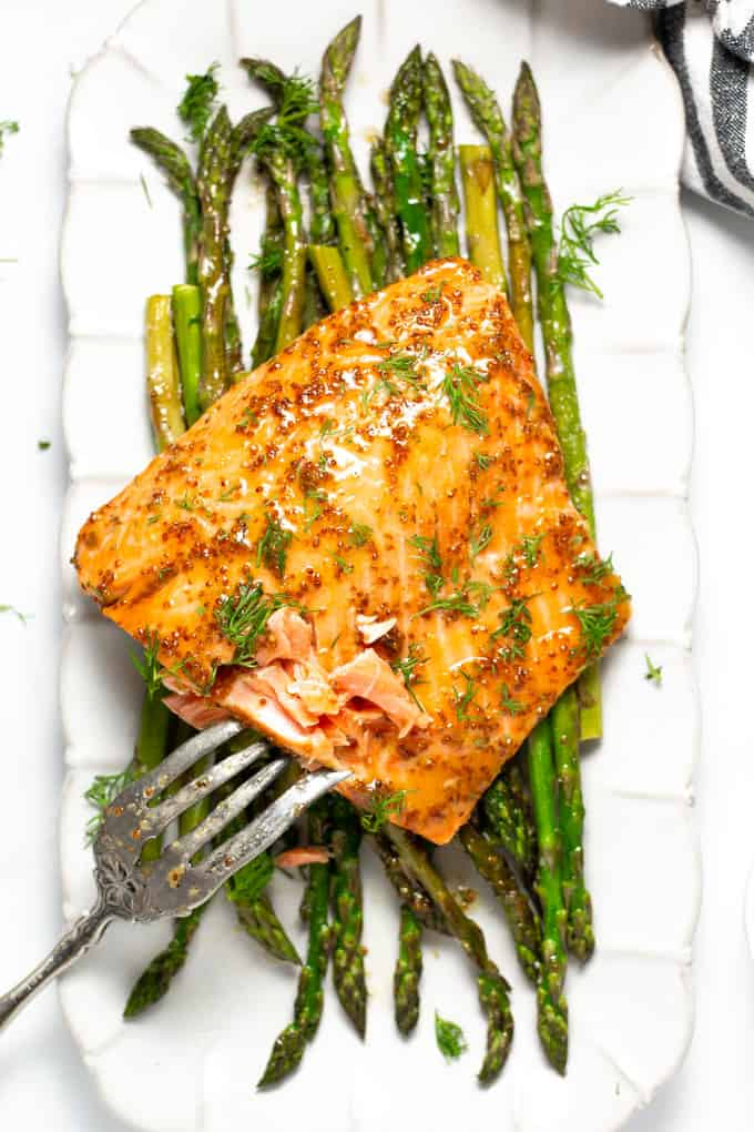 White platter filled with honey mustard sheet pan salmon and asparagus