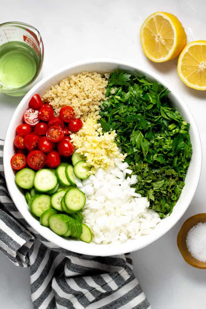 Overhead shot of a bowl filled with the ingredients to make tabbouleh
