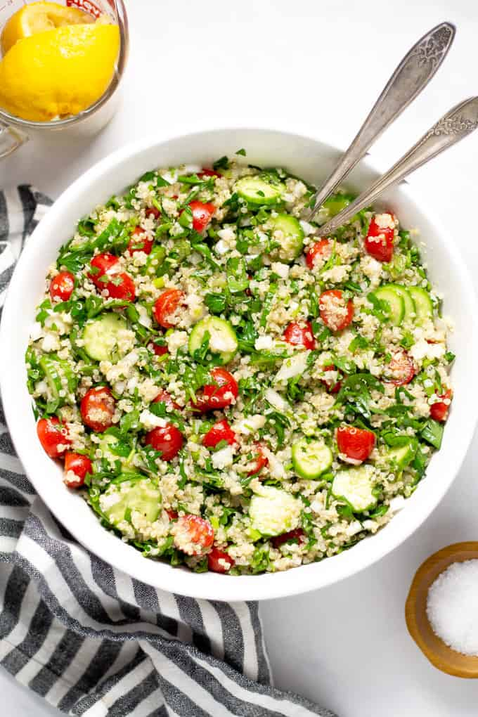 Overhead shot of a white bowl filled with tabbouleh
