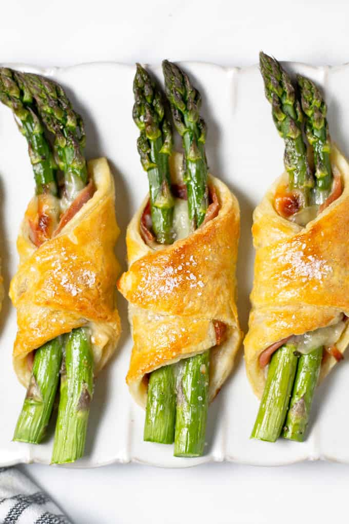 Overhead shot of prosciutto and Parmesan and puff pastry bundles