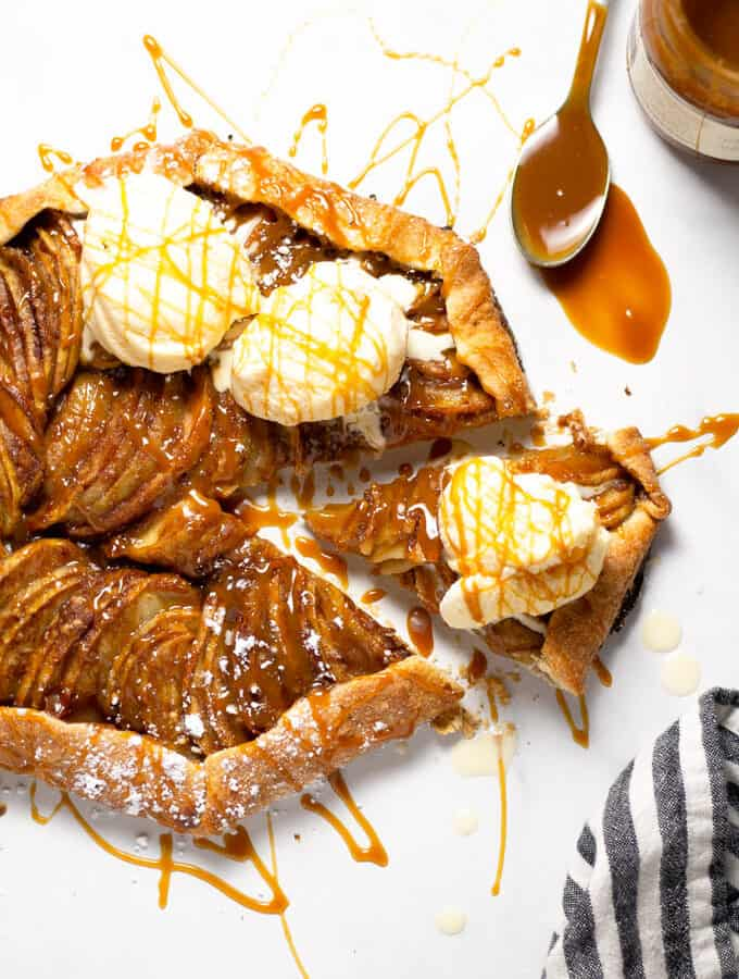 Overhead shot of an apple galette topped with caramel and ice cream