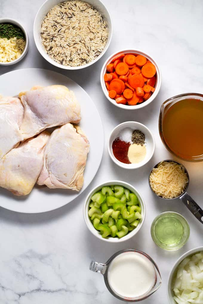 White marble counter top with ingredients to make chicken and rice casserole