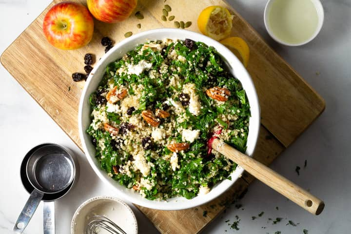 Large white bowl filled with fall harvest kale salad