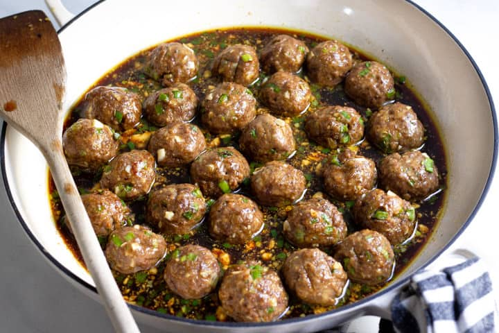 White saute pan filled with Korean beef meatballs