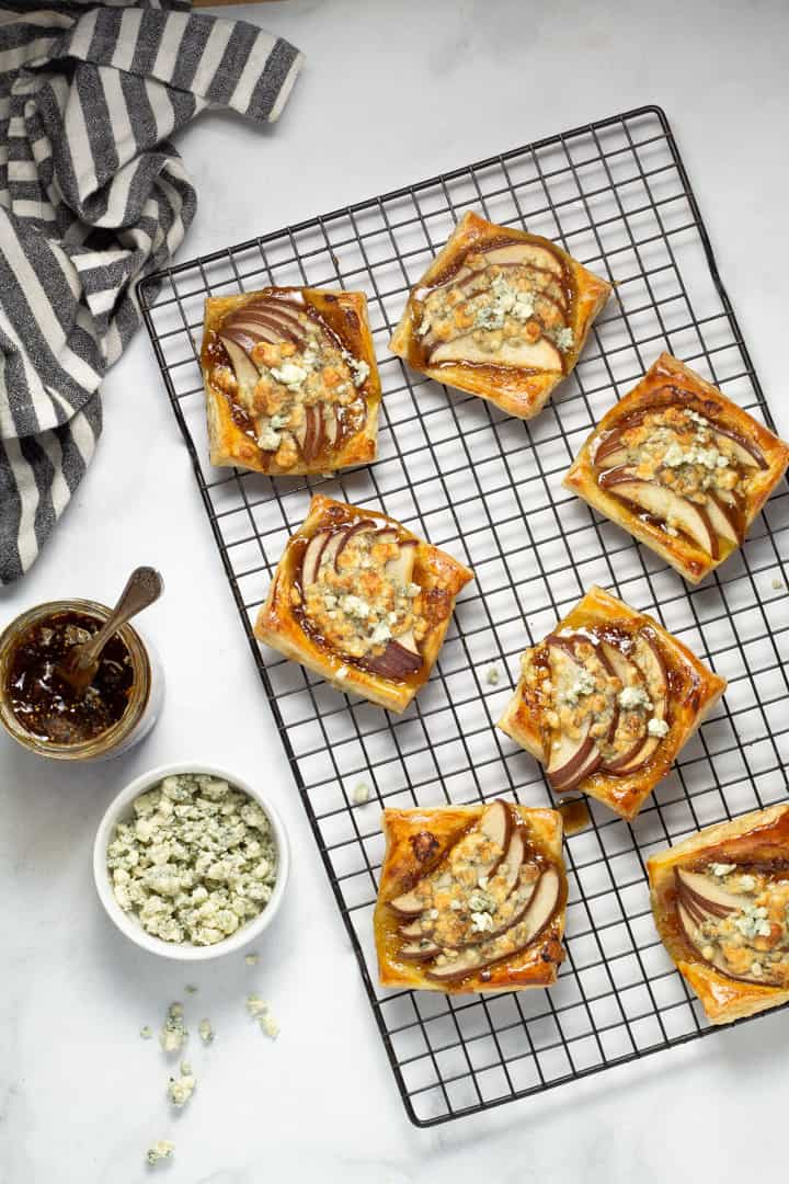 Overhead shot of pear tarts on a cooling rack