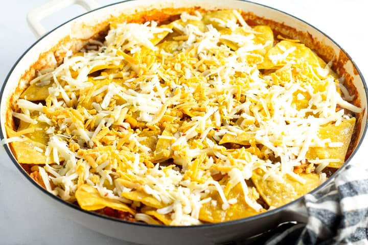 White saute pan filled with vegetarian one pan enchiladas